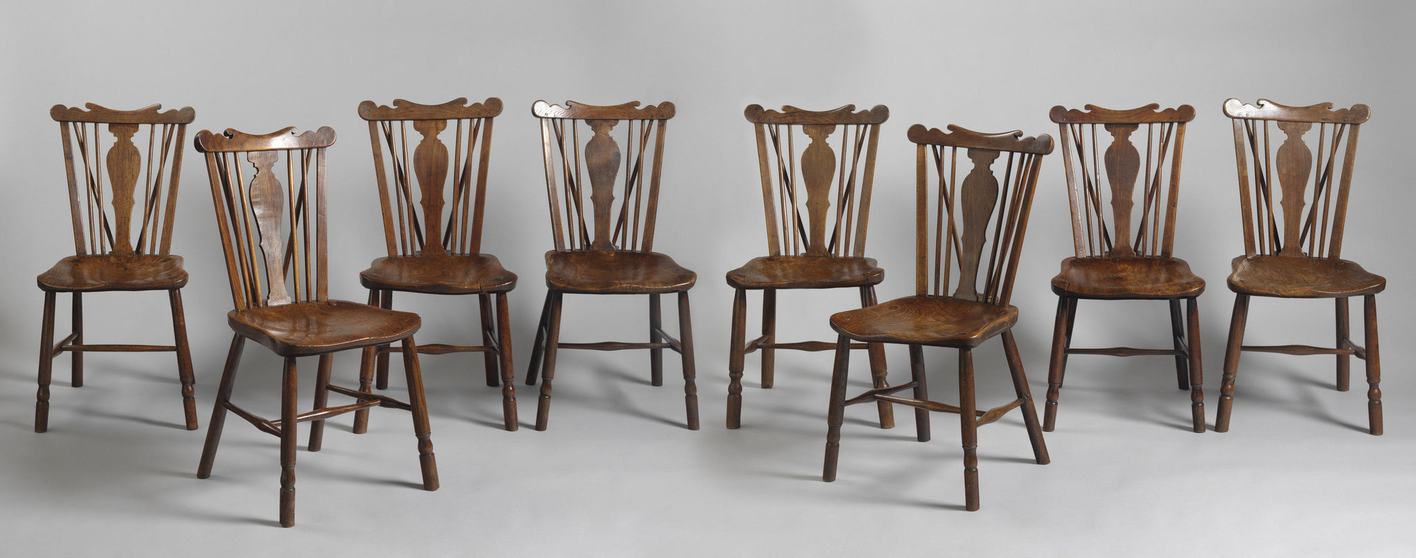 A Fine Matched Set of Eight Comb Back Windsor Dining Chairs