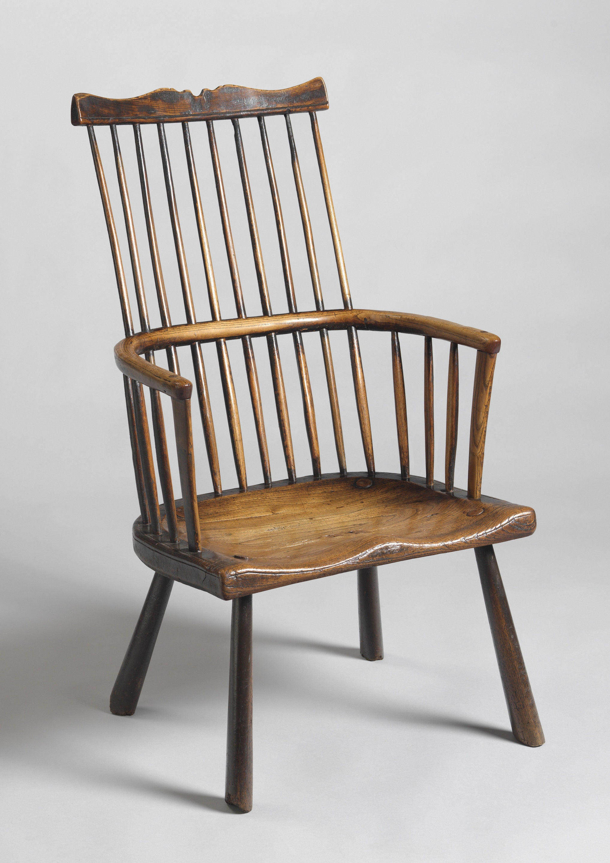A Rare Early Comb Back Windsor Chair