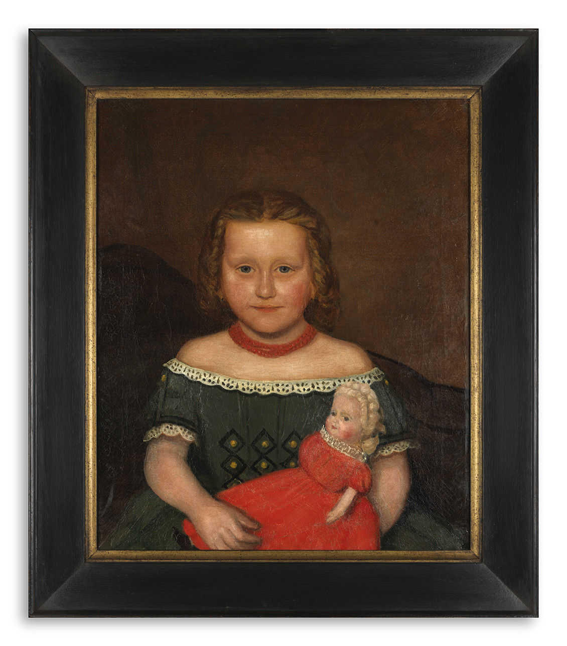 Young Girl Holding a Doll in a Red Dress