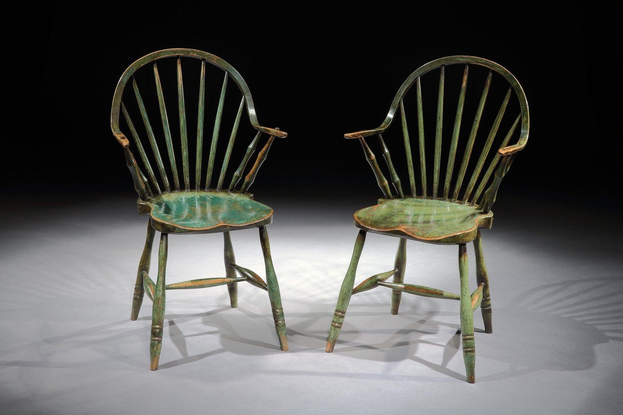 "Iconic Pair of ""Yealmpton"" Continuous Arm Windsor Chairs"