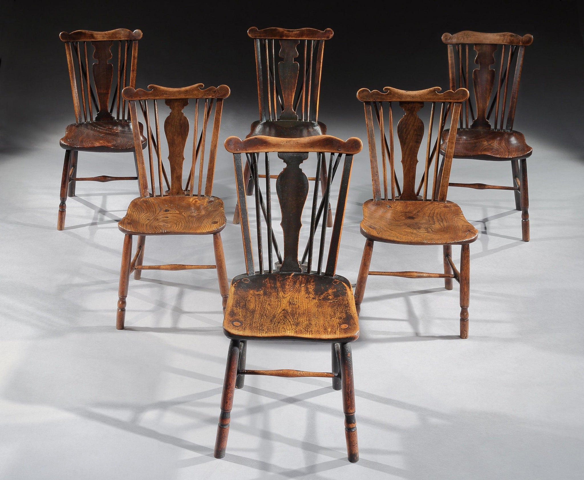 A Good Matched Set of Six Comb Back Windsor Chairs