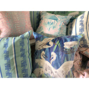 Pillow with nesting birds on a vivid marbled background.