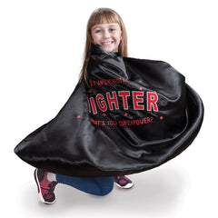 "little girl in open the joy's red and black ""I'm a fighter"" cape"
