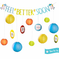 Open the Joy Feel better soon room decoration kit with blue orange green and yellow paper lanterns in three sizes, joy, love, hope and laugh posters to hang, and a get well soon banner with unicorns on it