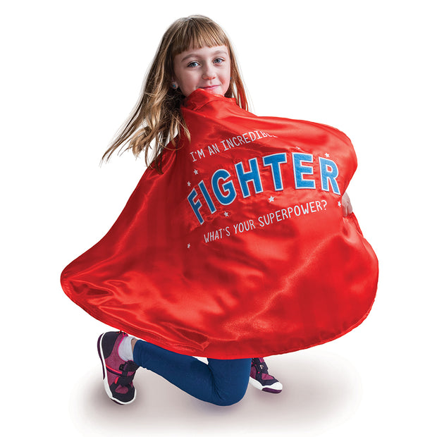 Little girl wearing open the joy's empowering fighter cape for children battling sickness or disease