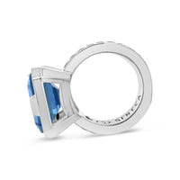large square cut blue topaz ring with woven ring design sterling silver