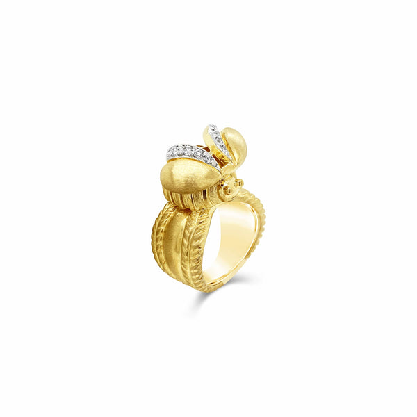 big gold bee ring with diamonds