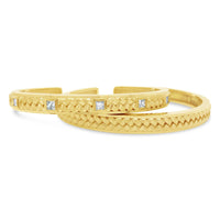 Herringbone bracelet cuffs with princess cut diamonds in 18k yellow gold
