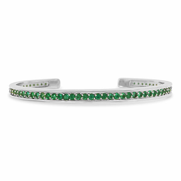 white gold tennis bracelet with emeralds
