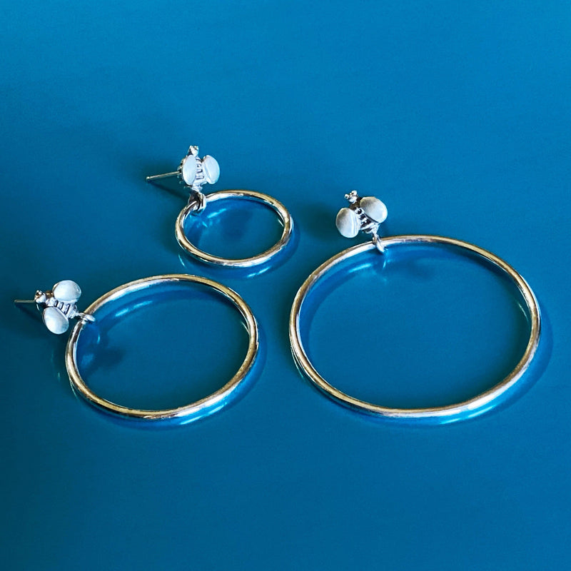 products/front_facing_silver_hoop_earrings.jpg