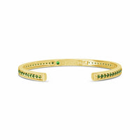 narrow gold bracelet with small green stones