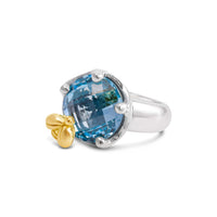 round faceted blue topaz ring
