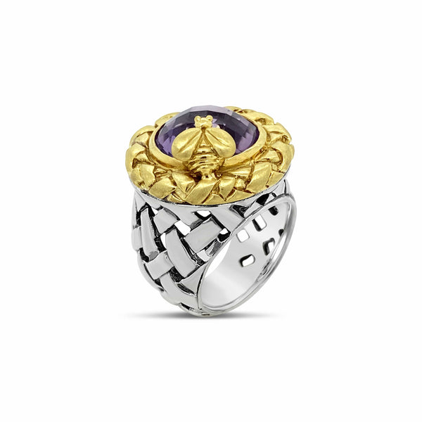 silver and gold ring with purple stone