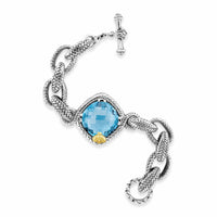silver bracelet with blue topaz