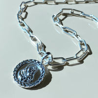 silver mother and child pendant