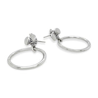 small silver hoop earrings with bees