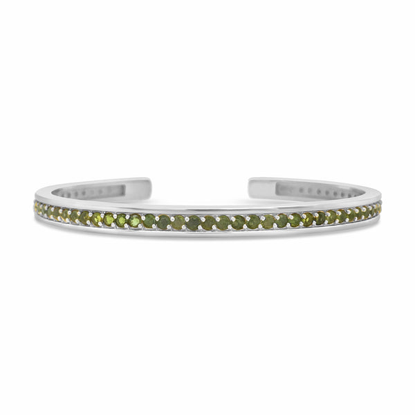 green tennis bracelet with white gold