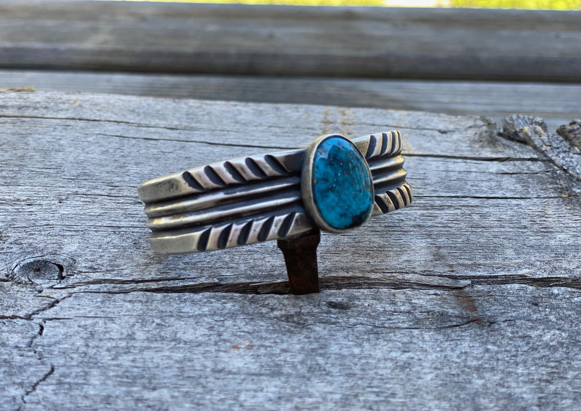 Silver bracelet with apache blue turquoise angled view