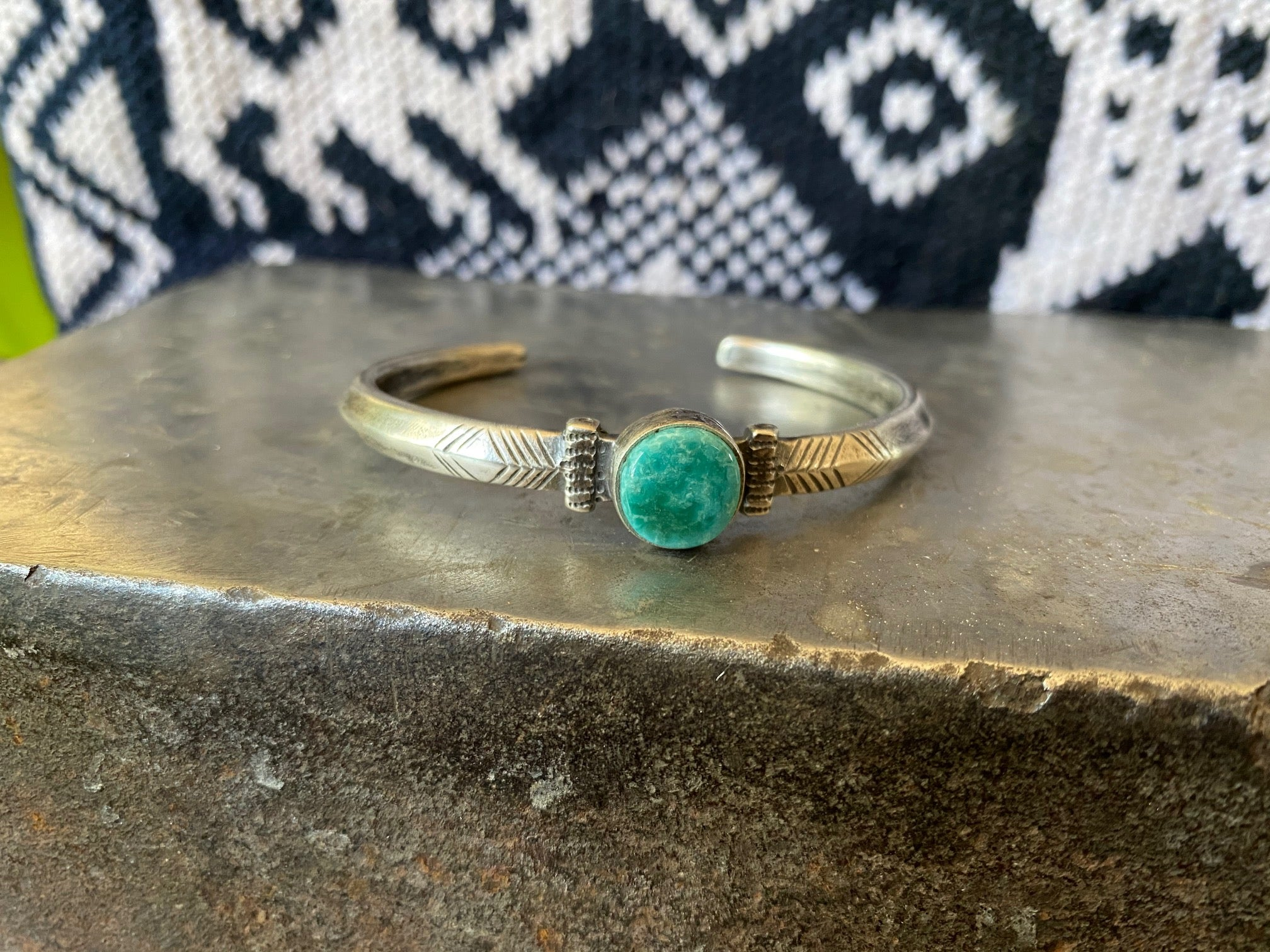 Silver bracelet with turquoise stone front