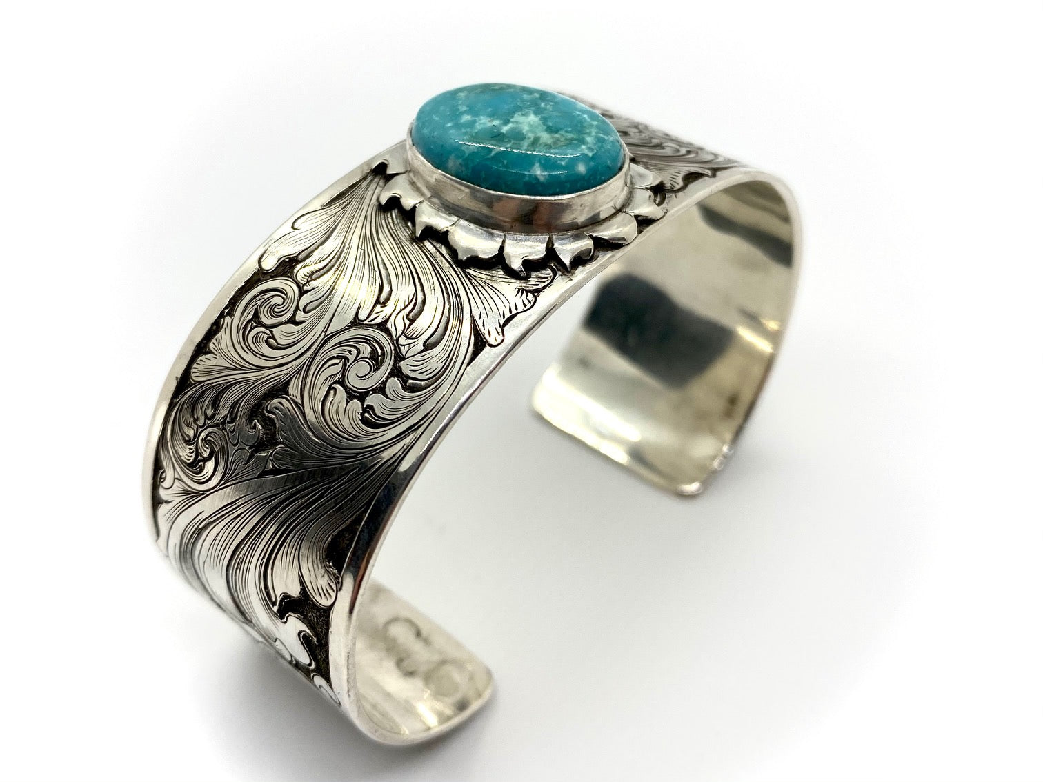 Engraved Sterling Silver Bracelet with Misty Blue turquoise stone angled view