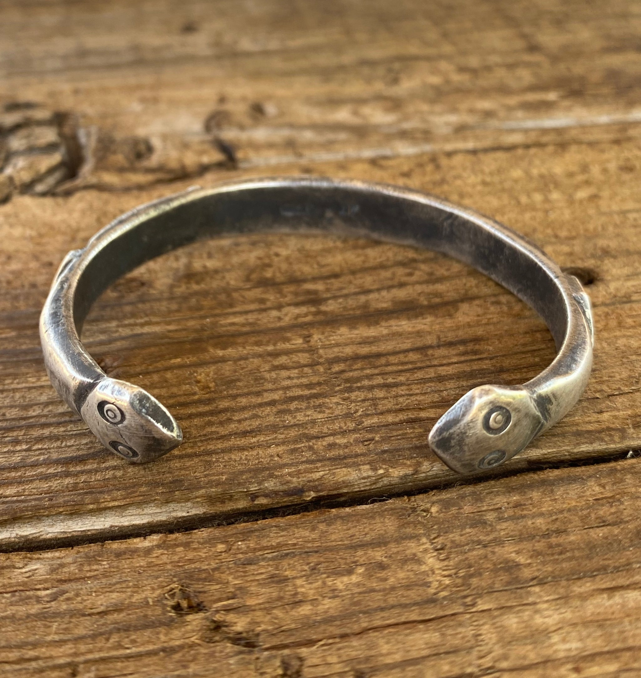silver bracelet with two rattlesnake heads back