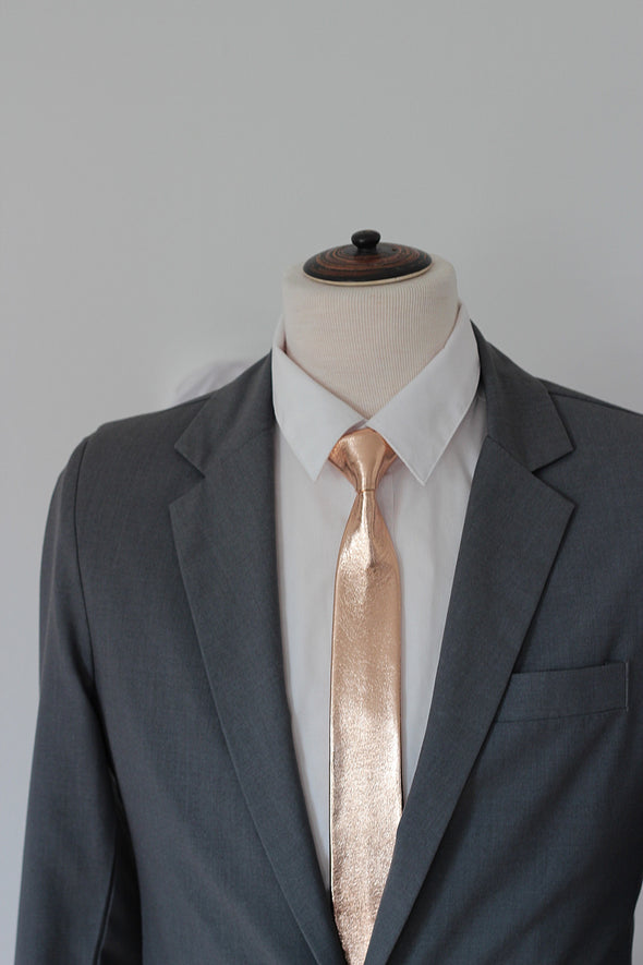 This is full length men's rose gold leather slim neck tie. It is prettied with good standing knot and attached with adjustable strap in rose gold.