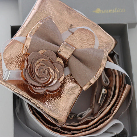 The rose gold copper and dusty pink leather and suede combined nevestica style bow tie, lapel flower boutonniere pin and suspender set for the groom and his litte boys.