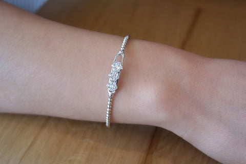 Sterling Silver Moving Flower Elastic Bracelet - SDG by Grace