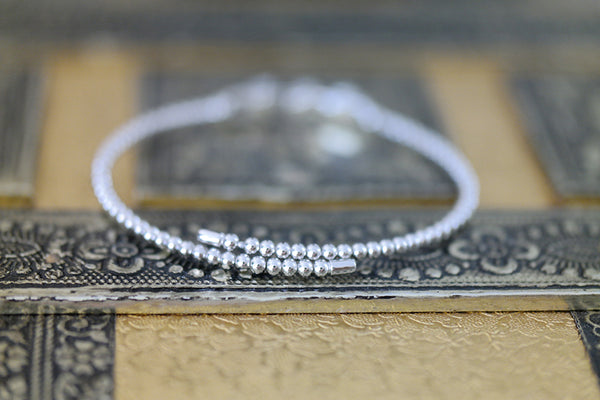 Sterling Silver Moving Flower Elastic Bracelet