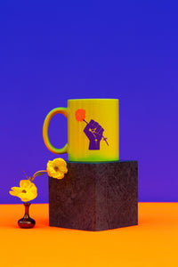 lime colored mug with purple fist and flower
