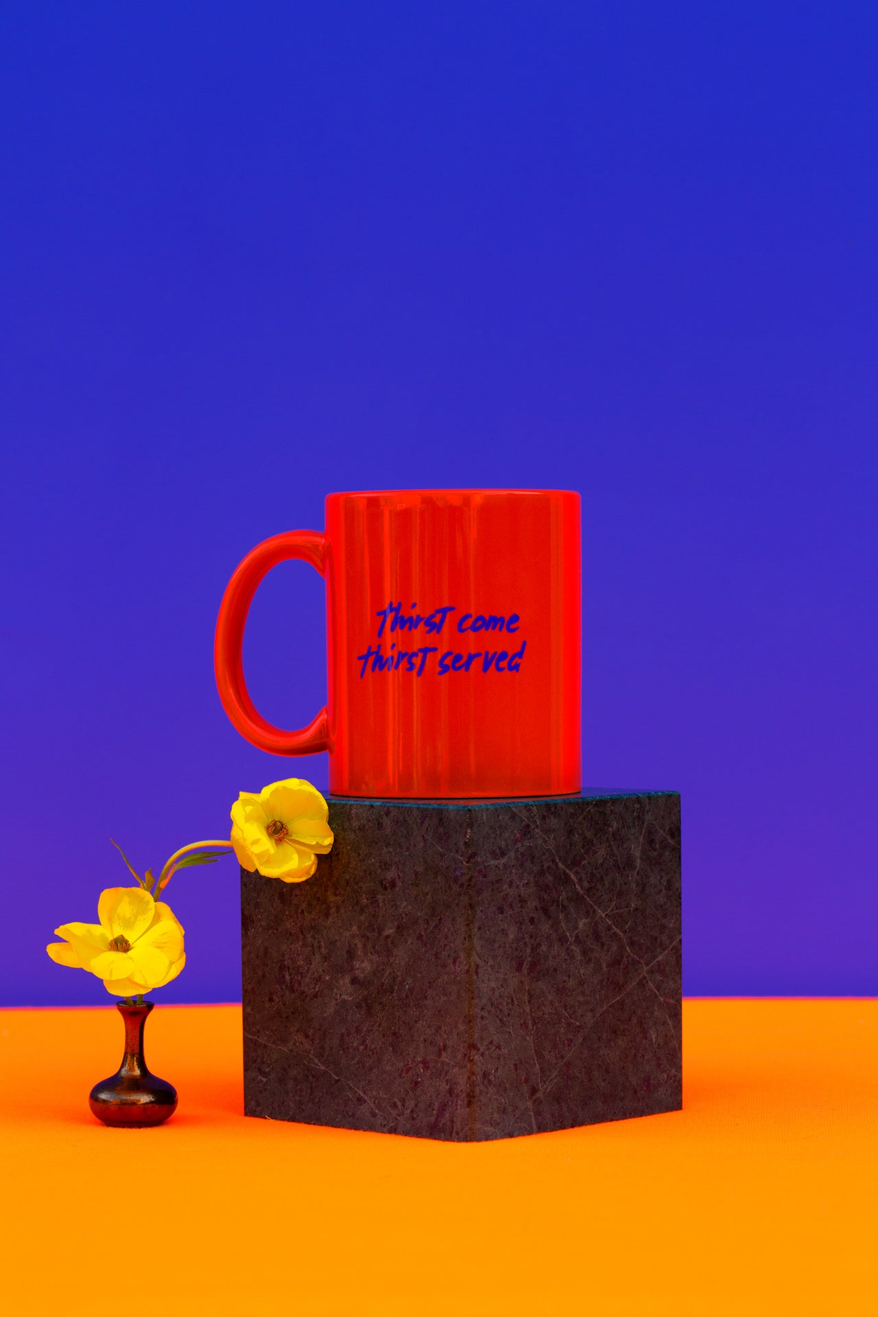 orange colored mug with thirst come, thirst serve