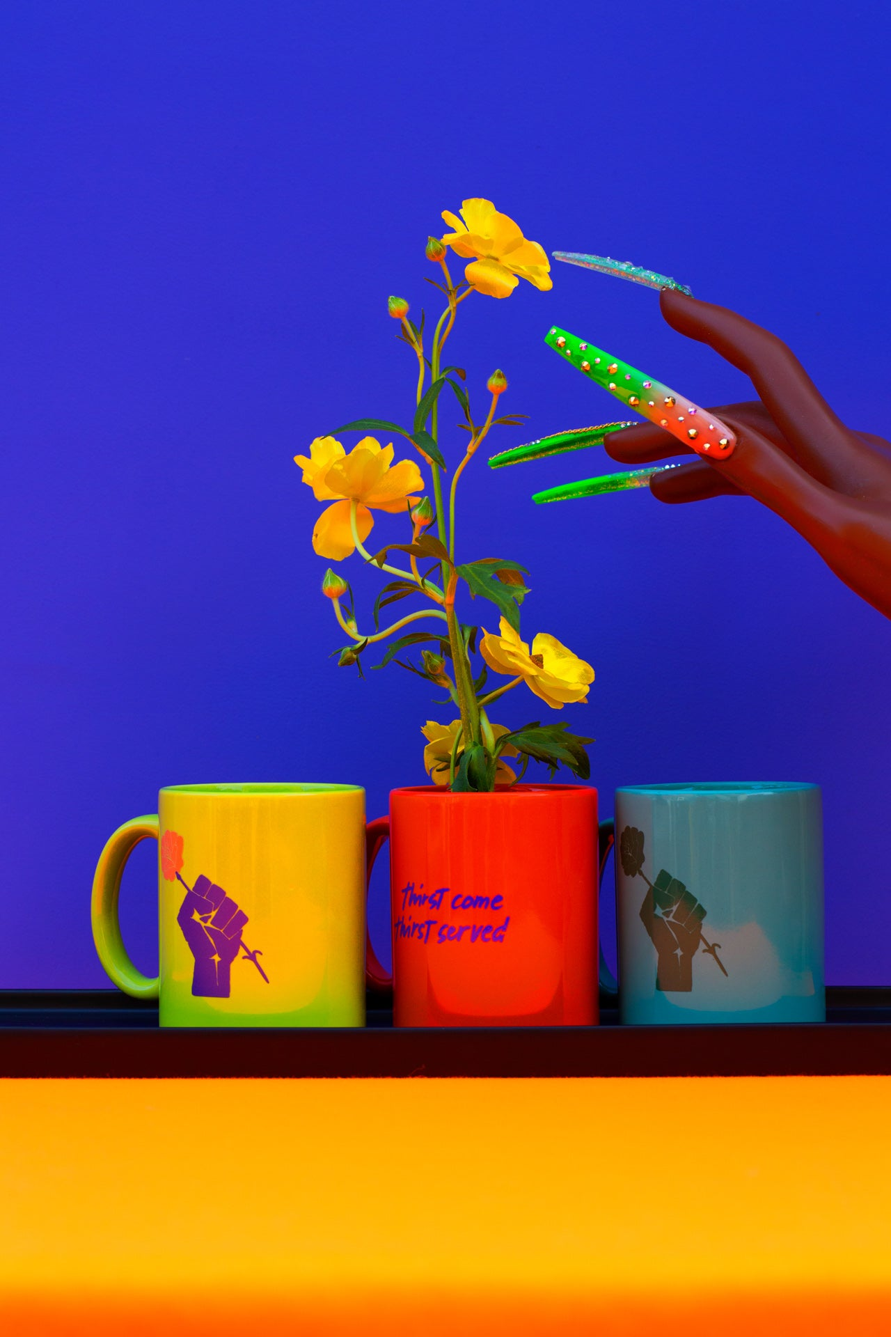 teal, lime, and orange mugs with yellow flowers