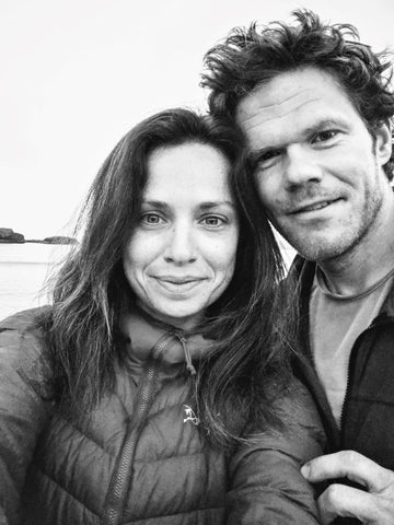Black and White image of Alkeme founders Melinda and Todd Kopet at the beach