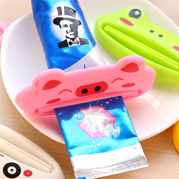 Cartoon Toothpaste Dispenser Rolling Holder