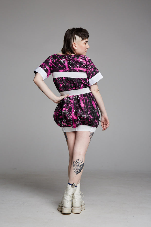 Pendulum Studios momentum dress pink white black painted deadstock linen, white straps and buckles