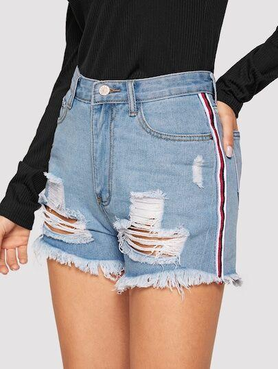 Torn denim shorts with torn edges wq51