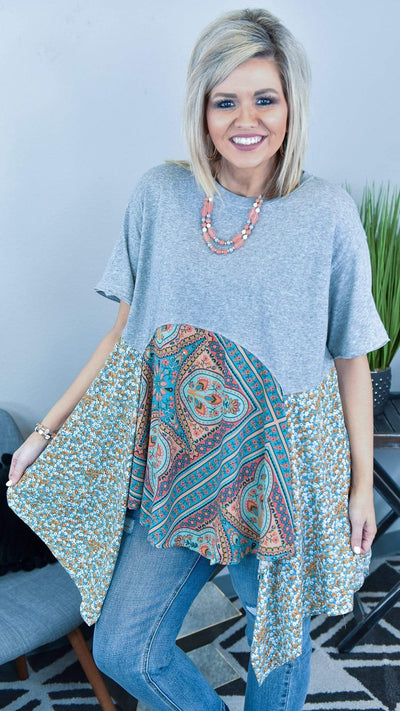 The ZigZag Stripe Easel Top Heather Grey Here We Are Tunic