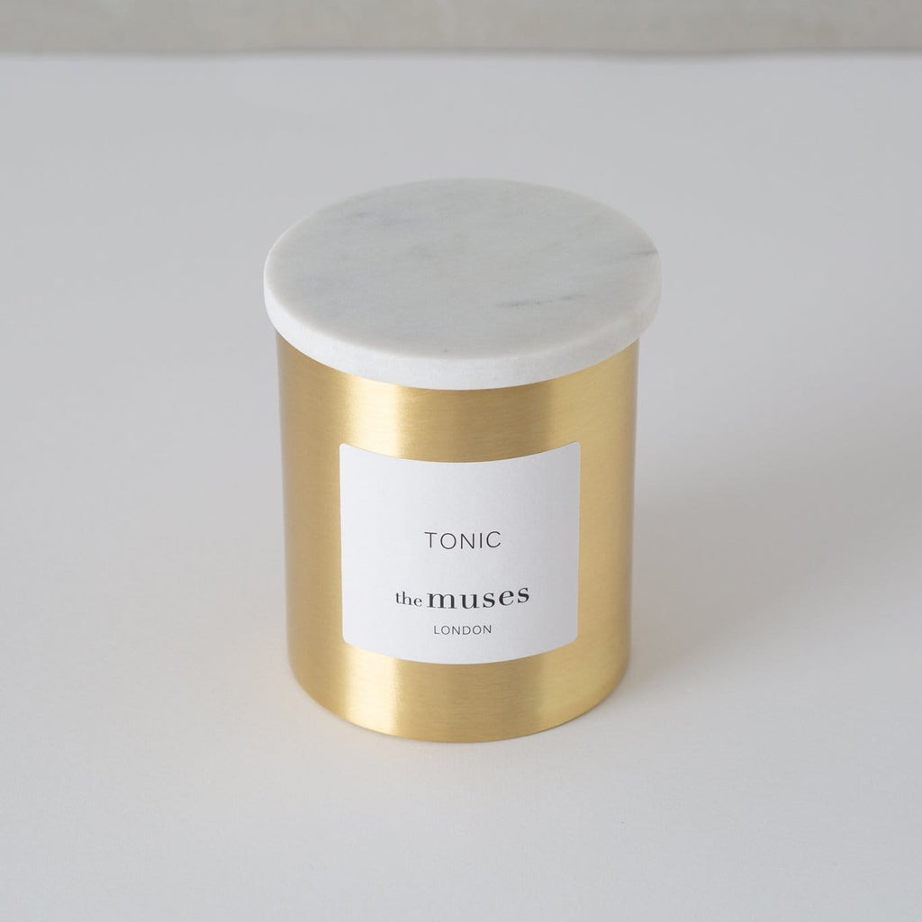 Tonic 100% natural wax candle in pure brass container with pure marble lid. Front view