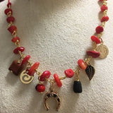 Coral necklace with amulets