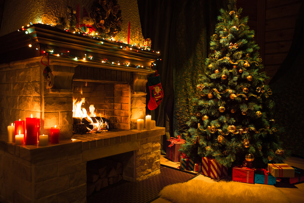 Christmas Tree and Lighted Mantel with Fire in the Fireplace