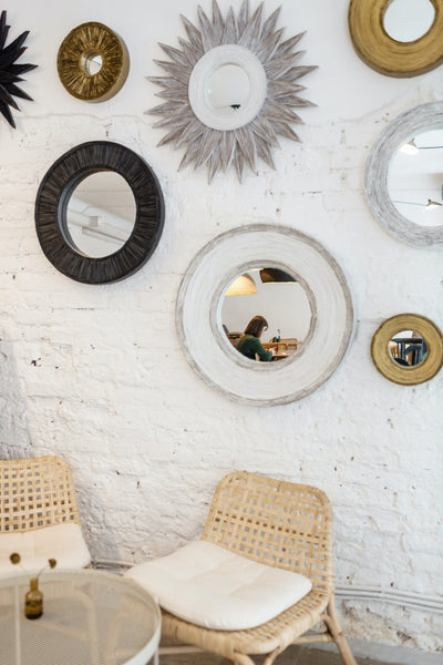 Cluster Small Mirrors to Fill A Space Stylishly
