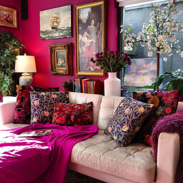 Maximalist interior with a unified color palette and art wall