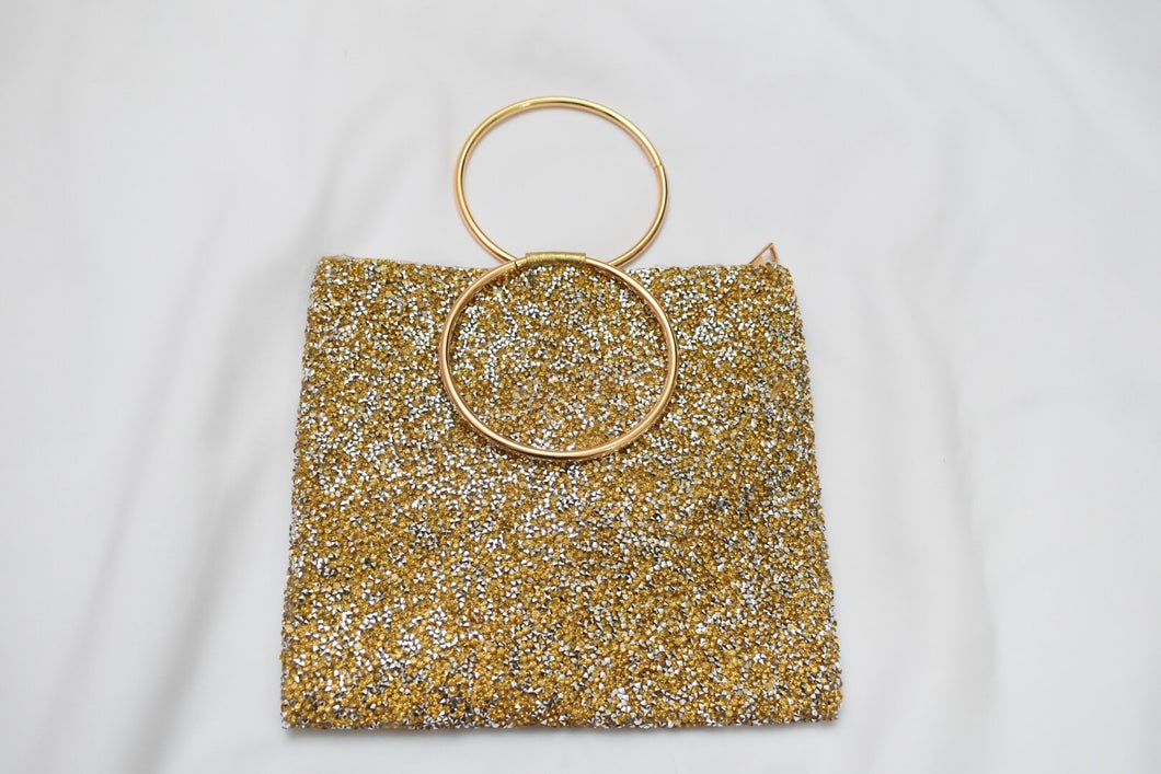 Trendy Gold colored Sparkly Hand Purse I with metal ring handle