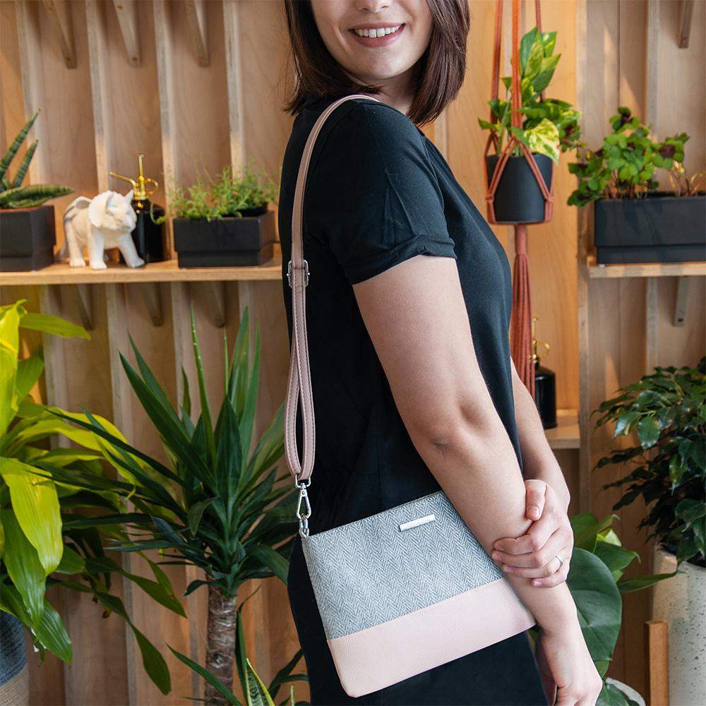 Chloe clutch from Kanevas, with long adjustable strap, worn at the shoulder; grey herringbones cotton and light pink vegan leather