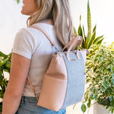 Convertible Emilie backpack from Kanevas; light pink vegan leather and grey herringbones cotton