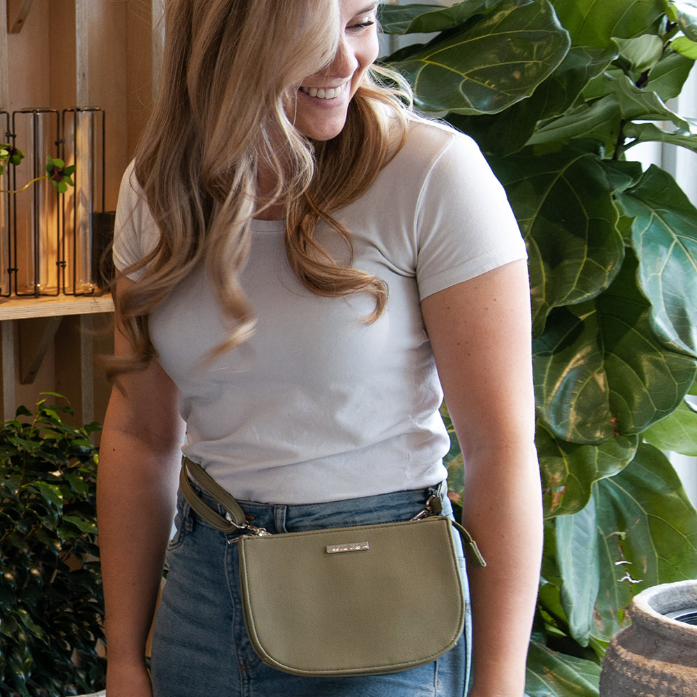 Jade convertible fanny pack from Kanevas, bag worn at the waist; olive vegan leather