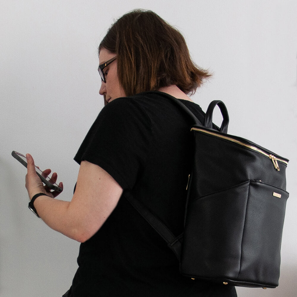 Stephanie techno midi backpack from Kanevas; in black vegan leather; with front zippered pocket