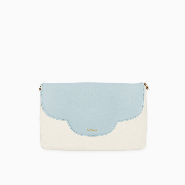 Sky flap from Kanevas' flap bag collection; removable and interchangeable; light blue vegan leather; pocket in beige vegan leather