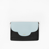 Sky flap from Kanevas' flap bag collection; removable and interchangeable; light blue vegan leather; pocket in black vegan leather
