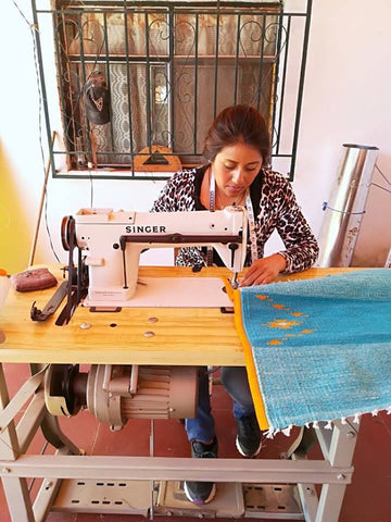 Marcela sewing a quality wool backpack at her home near Oaxaca, Mexico